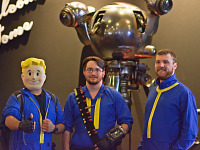 quakecon-dallas-2015 > Three vault dwellers cosplay in front of Mr Handy Showfloor Quakecon 2015
