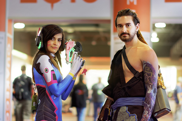 Two Quakecon cosplayers are Hanzo and DVA from the Overwatch game