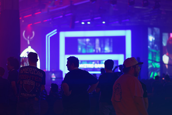 Silhouettes in the blue light of the e-sport arena of Quakecon 2017