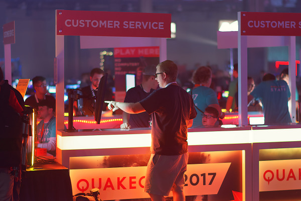 Orange light lit Customer Service booth at Quakecon 2017