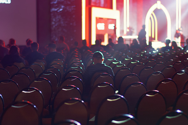 Bright lights shining on the chairs of the e-sport arena at Quakecon 2017