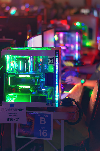 See through computer case with a green led lighting and fallout stickers at Quakecon 2017
