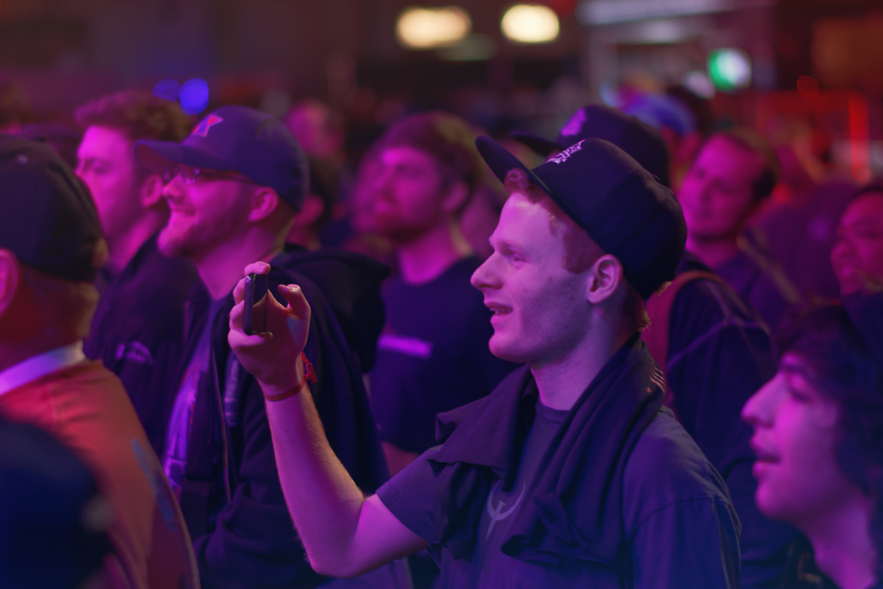 Attendee filming with his phone on the showfloor of Quakecon 2017