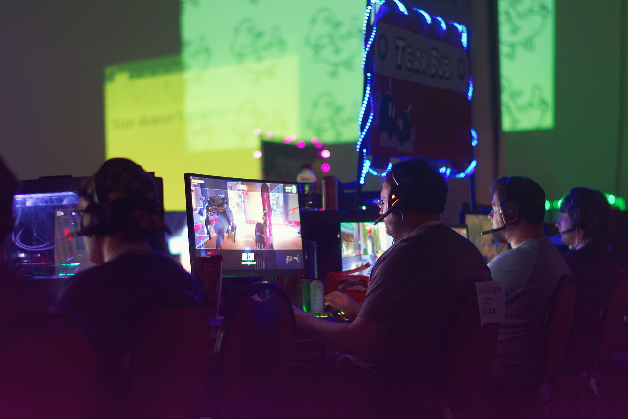 Team bob clan and their banner are computer lit during BYOC at Quakecon 2017