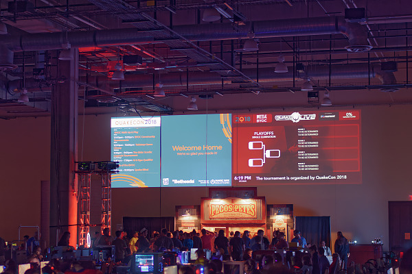 Big info display projected on walls of BYOC at Quakecon 2018