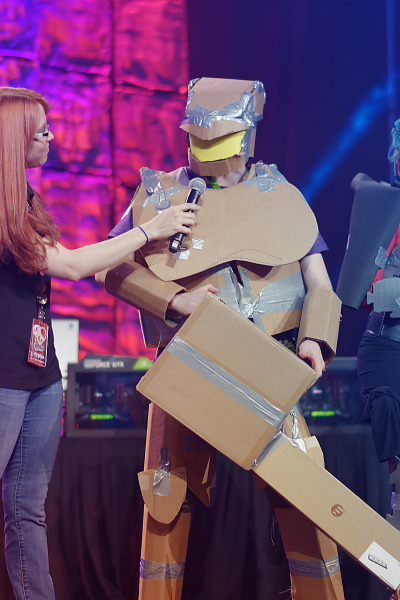 Cardboard Doom Guy costume on the stage of Quakecon 2018