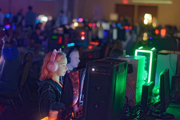 Quakecon player is wearing headphones with cat ears at Quakecon 2018
