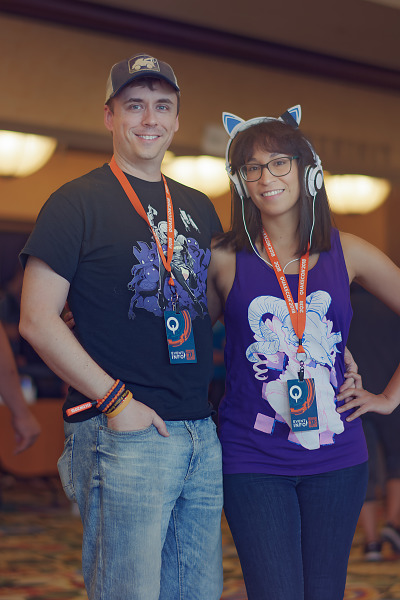 Couple of attendees with cat ears headphones in hallway of Quakecon 2018