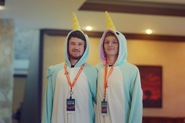 Narwhal Kigurumi attendees in hallway of Quakecon 2018
