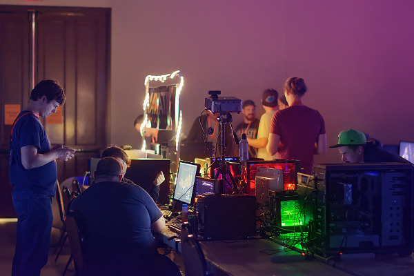 Gathering around PC Gaming lights at the BYOC of Quakecon 2018