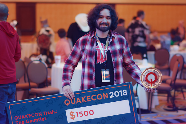 Winner of a big check at the Quakecon Trials during Quakecon 2018