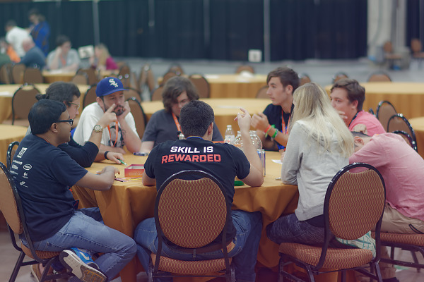 Tabletop village attendees playing board games at Quakecon 2018