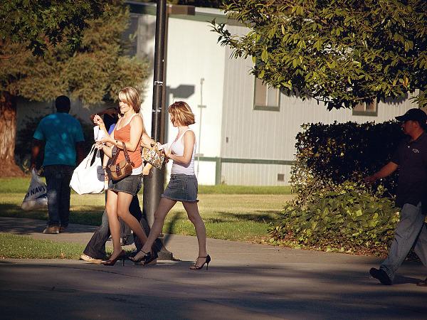 Two blond girls in jean skirt being followed at SJSU